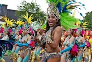 Performers take part in the Notting Hill Carnival in London on August 27. Revellers filled the streets of west London as Europe's biggest street festival reached its climax with its famous Caribbean-inspired parade