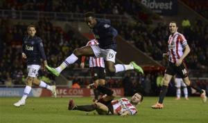 Manchester United's Welbeck jumps over Sunderland's Bardsley during their English League Cup semi-final first leg soccer match in Sunderland