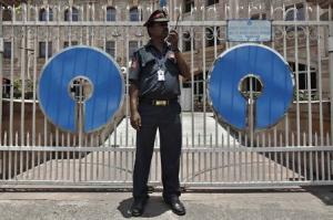 A security personnel stands guard in front of the State Bank of India regional office in Kolkata