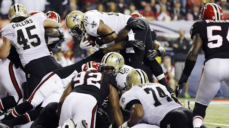 New Orleans Saints running back Mark Ingram (28) goes over the top to score a touchdown during the first half of an NFL football game against the Atlanta Falcons, Thursday, Nov. 29, 2012, in Atlanta. (AP Photo/David Goldman)