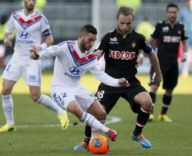 Olympique Lyon's Ferri challenges Germain of Monaco during their French Ligue 1 soccer match at the Gerland stadium