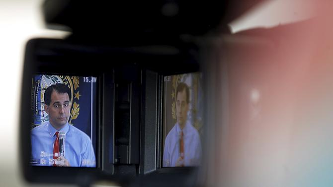 Potential Republican 2016 presidential candidate Wisconsin Governor Scott Walker is seen in a television viewfinder while speaking to local activists and elected officials in Derry