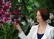 Australian Prime Minister Julia Gillard at the National Orchid Garden in Singapore on April 23. Gillard has defended her appointment of Peter Slipper as Australia&#39;s speaker as court documents alleged he used his position to pursue sexual relations with male employees