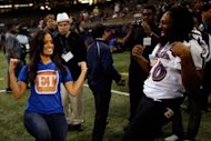 TV personality Rocsi Diaz of &#39;Entertainment Tonight&#39; dances with Damien Berry of the Baltimore Ravens during Super Bowl XLVII Media Day ahead of Super Bowl XLVII at the Mercedes-Benz Superdome on January 29, 2013 in New Orleans, Louisiana