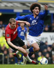 Manchester United's Darren Fletcher, left, vies for the ball against Everton's Marouane Fellaini during their English Premier League soccer match at Goodison Park, Liverpool, England, Saturday Oct. 29, 2011. (AP Photo/Tim Hales)