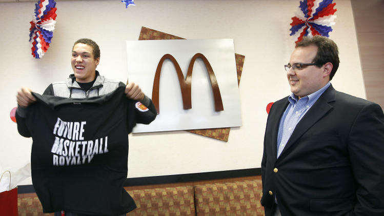 IMAGE DISTRIBUTED FOR MCDONALD'S - McDonald's All American Games player Aaron Gordon, from Archbishop Mitty High School, is celebrated in a send-off event by McDonald's owner/operator Cosme Fagundo, right, at a McDonald's restaurant  on Tuesday March 19, 2013, in San Jose, Calif.  The celebration is being held prior to the All American Games in Chicago on April 3rd. Three student athletes from the Bay Area were selected among 800 nominees to participate in McDonald's All American Games. The elite list of prep school stand outs has included Michael Jordan, Kobe Bryant and LeBron James. (Photo by Tony Avelar/Invision for McDonald's/AP Images)