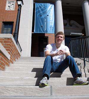 "This photo taken Sept. 20, 2012 shows Abraham Mulberry, an 18-year-old freshman, sitting on a campus hall step at Elmhurst College in Elmhurst, Ill. What a difference four years can make. In 2008, college campuses were filled with campaign posters and political rallies _ and frenzy. Remember ""Obamamania?"" This year, it's difficult to find a college student who's truly excited about the presidential race.  (AP Photo/Martha Irvine)"