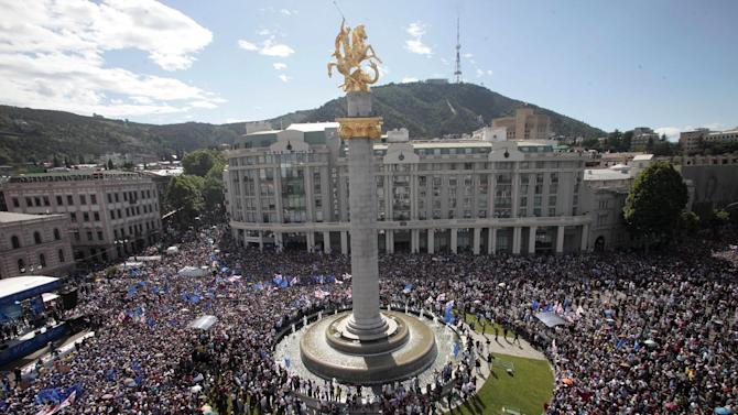 Gergian opposition supporters gather on the square in Tbilisi, the capital of Georgia, Sunday, May 27, 2012, with the column of George the Victorious in the center. Tens of thousands of people have thronged the streets of Georgia's capital to show their opposition to President Mikhail Saakashvili, in the largest anti-government demonstration in three years. The demonstration, which drew at least 40,000 people, was seen as a test of the opposition's public support in Tbilisi ahead of a parliamentary election in October. (AP Photo/George Abdaladze)