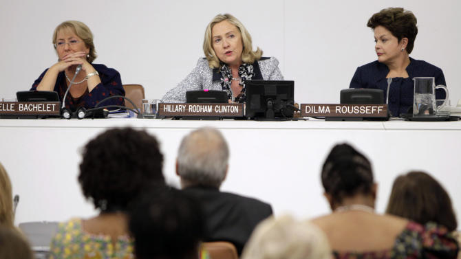U.S. Secretary of State Hillary Rodham Clinton, center, speaks while Brazilian President Dilma Rousseff, right, and former Chilean President Michelle Bachelet listen during an event about women's political participation during the 66th session of the General Assembly at United Nations headquarters Monday, Sept. 19, 2011.  (AP Photo/Seth Wenig)