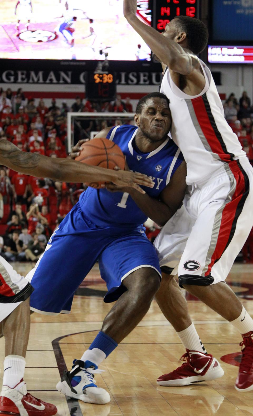 Kentucky guard Darius Miller, left, drives against Georgia guard Kentavious Caldwell-Pope in the second half of an NCAA college basketball game Tuesday, Jan. 24, 2012, in Athens, Ga. Kentucky won 57-44. (AP Photo/John Bazemore)