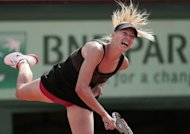 Russia&#39;s Maria Sharapova serves to China&#39;s Peng Shuai during their French Open match at the Roland Garros stadium in Paris. Sharapova won 6-2, 6-1