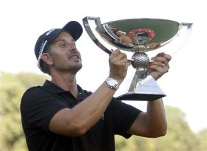 Stenson of Sweden holds up the FedExCup trophy toward the gallery in Atlanta