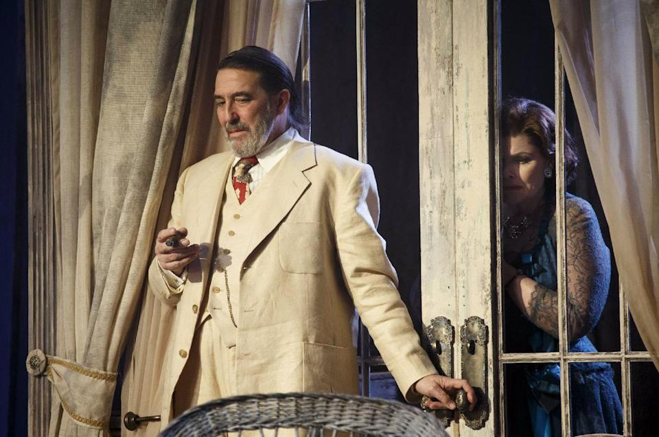 "This undated theater image released by Boneau/Bryan-Brown shows Ciaran Hinds, left, and Debra Monk during a performance of ""Cat on a Hot Tin Roof,"" playing at the Richard Rodgers Theatre in New York. (AP Photo/Boneau/Bryan-Brown, Joan Marcus)"