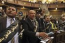 Independent members of Shura Council, shout slogans against the new judicial law during its meeting in Cairo