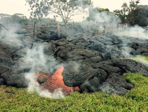 The lava flow from the Kilauea Volcano is seen near the village of Pahoa, Hawaii