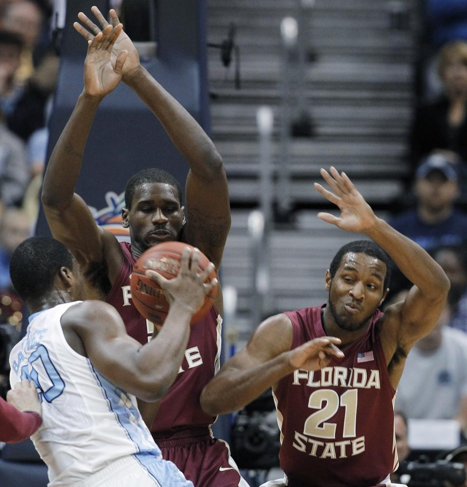North Carolina forward Harrison Barnes (40) works against Florida State forward Bernard James (5) and guard Michael Snaer (21) during the first half of an NCAA college basketball game in the final of the Atlantic Coast Conference men's tournament, Sunday, March 11, 2012, in Atlanta. (AP Photo/John Bazemore)