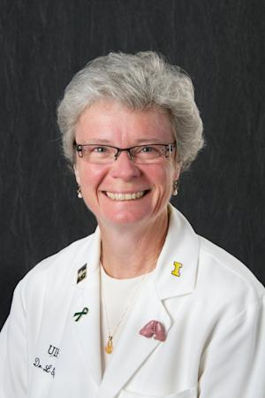 This undated photo provided by the University of Iowa shows Lois Geist, associate medical school dean. The University of Iowa is fighting criminal charges filed against Geist and former dean Paul Rothman by fired professor Malik Juweid in his native country of Jordan. University spokesman Tom Moore says the charges against Geist and Rothman are baseless and part of a harassment campaign by fired radiology professor. Moore says the university has retained a Jordanian lawyer, and questions how two Americans who've never been to Jordan can be subject to its courts. (AP Photo/The University of Iowa)