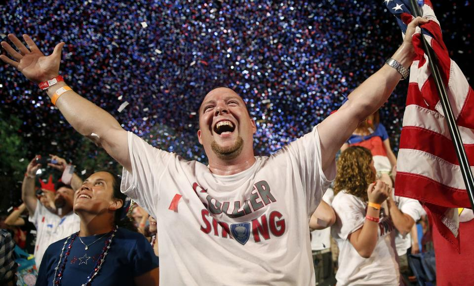Scott Webb, of Waldorf, Md., celebrates during the finale of the Boston Pops Fourth of July Concert at the Hatch Shell in Boston, Thursday, July 4, 2013. (AP Photo/Michael Dwyer)