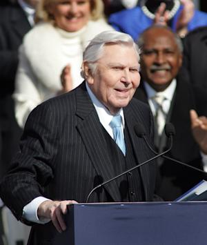 FILE -In this Saturday, Jan. 10, 2009 file photo, Actor Andy Griffith reads a poem after North Carolina Gov. Beverly Perdue was sworn into office during North Carolina inaugural ceremonies at the State Library building in Raleigh, N.C. The widow of actor Andy Griffith has gotten a permit to tear down the house where he lived for many years on the North Carolina waterfront, upsetting friends who had hoped it would be preserved. Dare County records show Cindi Griffith obtained the demolition permit Monday, March 18, 2013.(AP Photo/Jim R. Bounds, File)