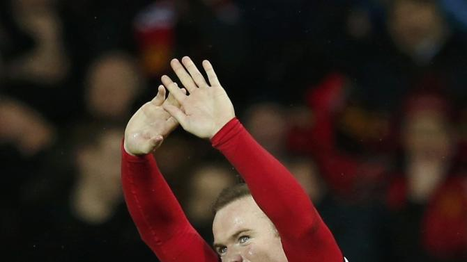 Manchester United's Wayne Rooney celebrates after scoring his second goal against Newcastle during their English Premier League soccer match at Old Trafford in Manchester