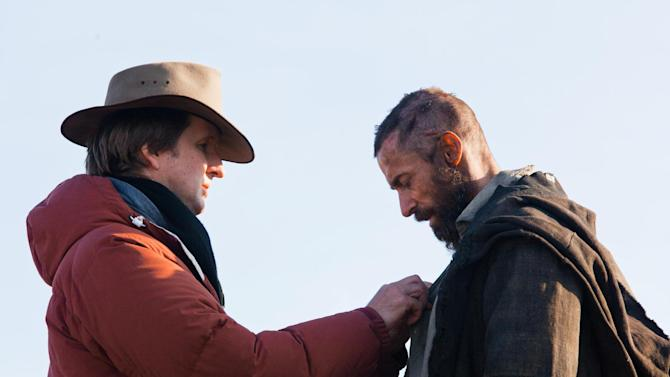 "This undated publicity photo provided by Universal Pictures shows Oscar®-winning director, Tom Hooper, left, and Hugh Jackman right, as Jean Valjean on the set of Hooper's new film, ""Les Misérables,"" the motion-picture adaptation of the beloved global stage musical adapted from Victor Hugo's novel. (AP Photo/Universal Pictures/Laurie Sparham)"