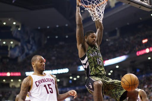 Irving lifts Cavaliers past Raptors 99-98