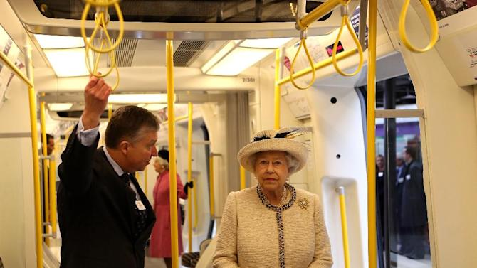 Britain's Queen Elizabeth II is shown round the carriage of a parked train at Baker Street underground station in London, for a visit to mark the 150th anniversary of the London Underground, Wednesday, March 20, 2013.  The Queen made her first public engagement in more than a week Wednesday after cancellations following her hospitalization for a stomach bug.  The British head of state joined her husband Prince Philip and their granddaughter-in-law, Kate, for the event marking the 150th anniversary of London's sprawling subway system, affectionately known as the Tube.  (AP Photo/Chris Radburn, Pool)