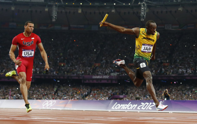 Jamaica&#39;s Usain Bolt, right, crosses the finish line ahead of Ryan Bailey of the United States in the men&#39;s 4x100-meter relay final during the athletics in the Olympic Stadium at the 2012 Summer Olympics, London, Saturday, Aug. 11, 2012. Jamaica set a new world record with a time of 36.84 seconds. (AP Photo/Matt Dunham)