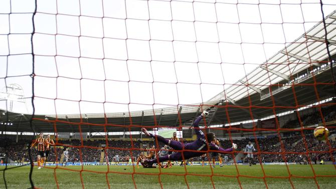 Newcastle United's Remy Cabella shoots to score a penalty goal during their English Premier League soccer match at the KC Stadium in Hull