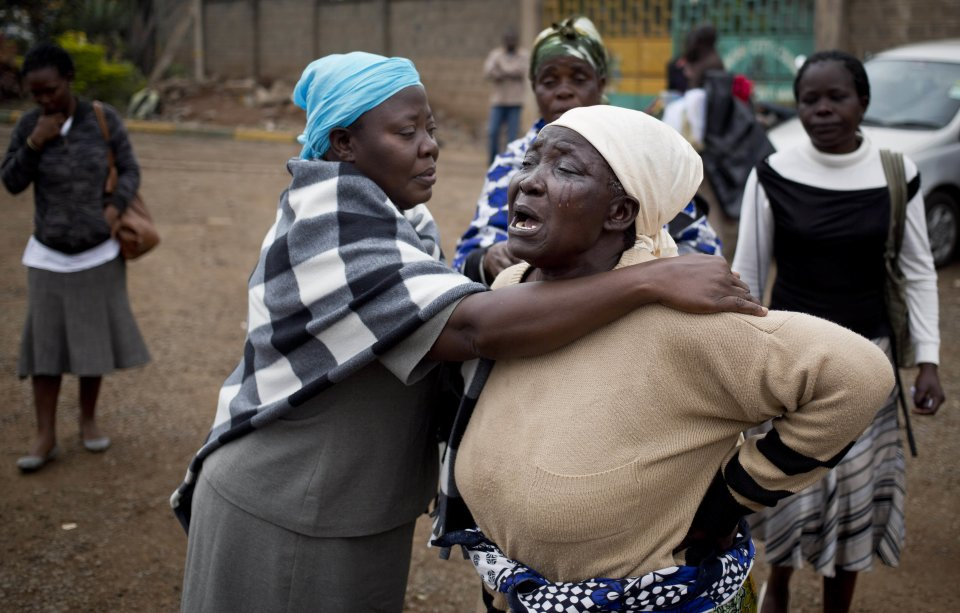 Mary Italo, center right, grieves with other relatives for her son Thomas Abayo Italo, 33, who was killed in the Westgate Mall attack, as they wait to receive his body at the mortuary in Nairobi, Kenya Wednesday, Sept. 25, 2013. Thomas was an accountant and the breadwinner of the family who helped look after Mary who is sick, according to relatives. Kenyan authorities prepared for the gruesome task of recovering dozens more victims than initially feared after the country's president declared an end Tuesday to the four-day siege of a Nairobi mall by al-Qaida-linked terrorists. (AP Photo/Ben Curtis)