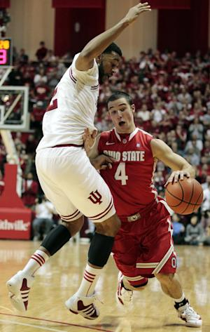Ohio State's Aaron Craft drives to the basket against Indiana's Christian Watford during the first half of an NCAA college basketball game, Saturday, Dec. 31, 2011, in Bloomington, Ind. (AP Photo/Darron Cummings)