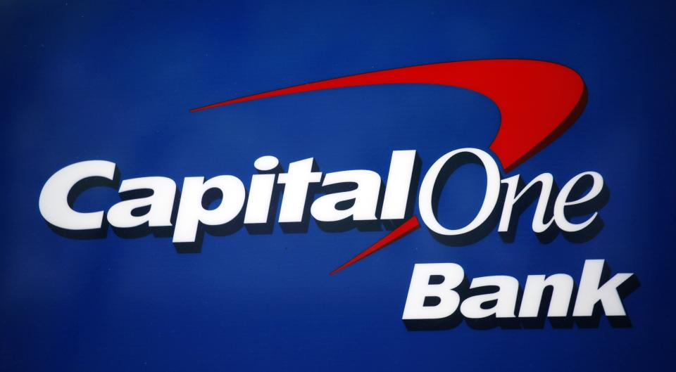 Capital One 1Q profit drops 25 pct; sales up