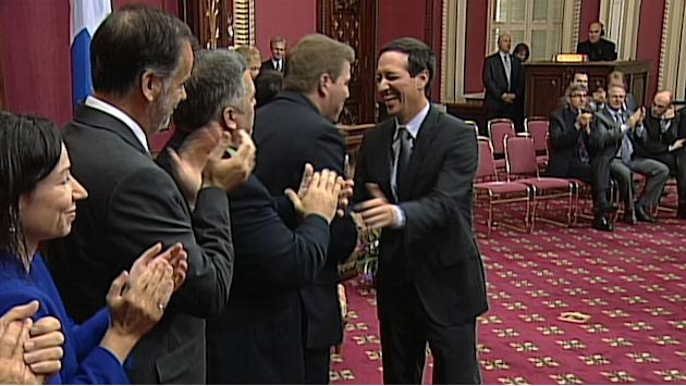 Freshly appointed Treasury Board President Stéphane Bédard, right, shakes hands with cabinet colleagues, from right, Pascal Bérubé (tourism), Daniel Breton (environment), Pierre Duchesne (higher educa