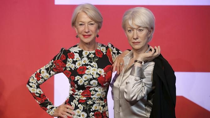 British actor Helen Mirren poses with a waxwork model of herself at Madame Tussauds in London