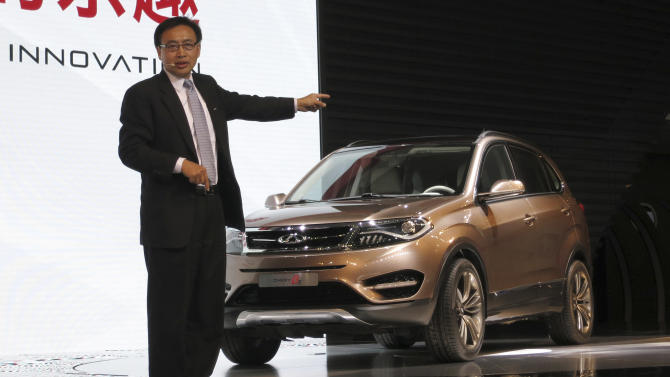 Chen Anning, vice general manager of Chery Auto, unveils Chery's BETA 5 car at the Shanghai International Automobile Industry Exhibition (AUTO Shanghai) media day in Shanghai, China Saturday, April 20, 2013. (AP Photo)