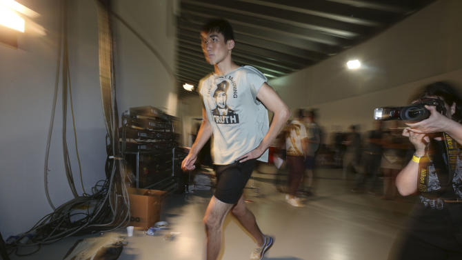 A model runs during rehearsals of the Vivienne Westwood men's Spring-Summer 2014 fashion show, part of the Milan Fashion Week, unveiled in Milan, Italy, Sunday, June 23, 2013. The shirt portrays US Army soldier Bradley Manning, who was arrested in 2010 on suspicion of having made public classified material through the website WikiLeaks. (AP Photo/Luca Bruno)