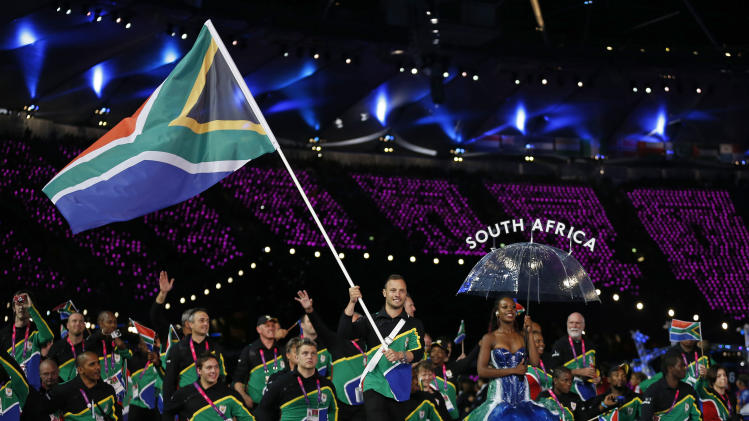 South Africa's flagbearer runner Oscar Pistorius leads his team during the Opening Ceremony for the 2012 Paralympics in London, Wednesday Aug. 29, 2012. (AP Photo/Matt Dunham)