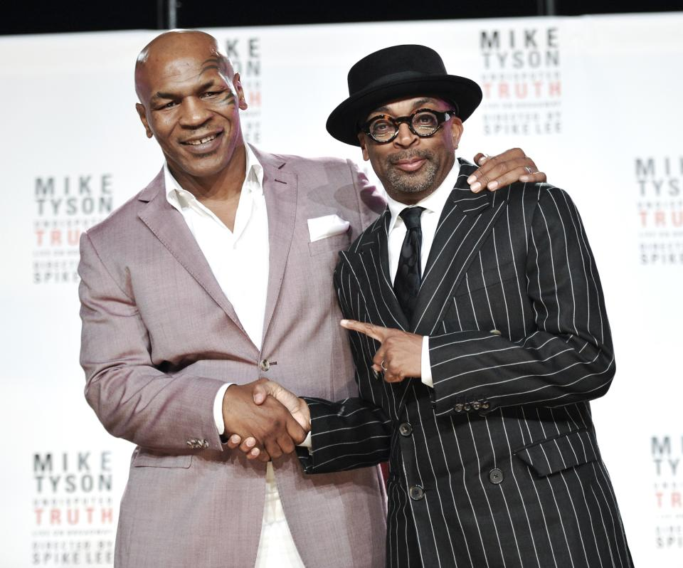 "Former heavyweight boxer Mike Tyson, left, and director Spiken Lee announce ""Mike Tyson: Undisputed Truth"", a one man show on Broadway starring Mike Tyson, on Monday June 18, 2012 in New York. (Photo by Evan Agostini/Invision)"