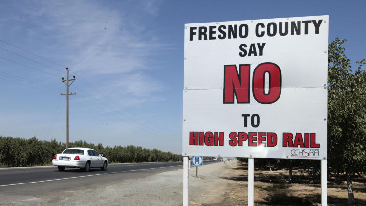 FILE -- In In this Sept. 13, 2012 file photo  a sign against the proposed high-Speed rail system is seen on Highway 43 near Hanford, Calif.    Sacramento Superior Court Judge Timothy Frawley is expected to decide Friday, Nov. 16, 2012 whether to grant a preliminary injunction   that would temporarily halt the project. Groups representing Central Vally farmers claim in the lawsuits that the California High Speed Rail Authority failed to conduct through environmental reviews and comply with public meeting laws. (AP Photo/Rich Pedroncelli, file)