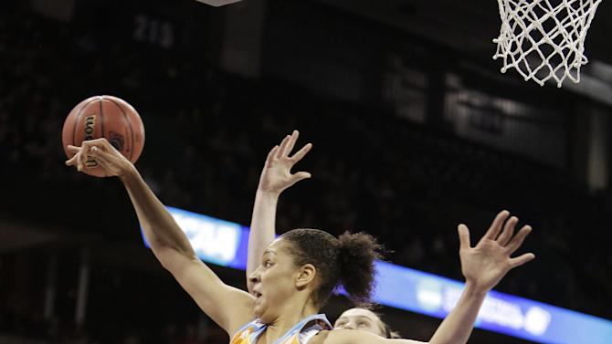 Tennessee's Cierra Burdick (11) blocks a shot by Maryland's Tierney Pfirman during the first half of a women's college basketball regional final game in the NCAA tournament, Monday, March 30, 2015, in Spokane, Wash. (AP Photo/Young Kwak)