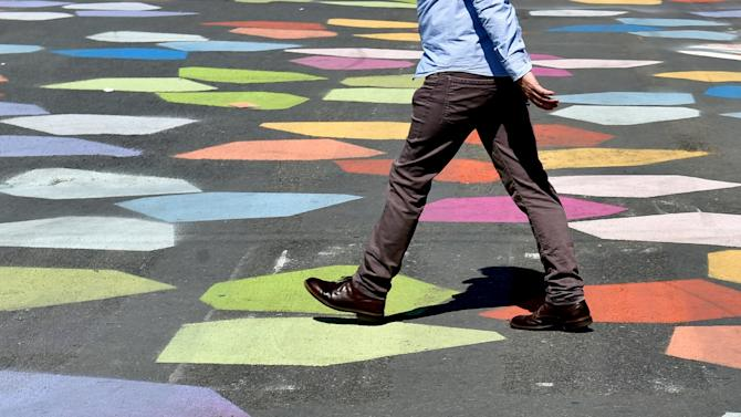A person walks at the pedestrian area in Brussels