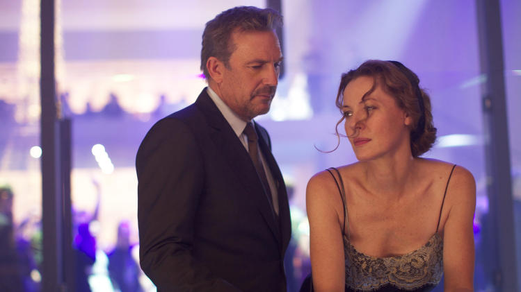 "This image released by Relativity Media shows Kevin Costner, left, and Connie Nielsen in a scene from ""3 Days to Kill."" (AP Photo/Relativity Media, Julian Torres)"