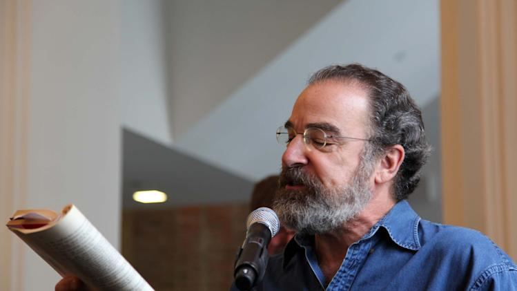 "This Oct. 4, 2012, photo shows actor Mandy Patinkin reading a line from Shakespeare's ""The Tempest"" during a celebration to help rededicate The Public Theater's new four-year, $40 million face-lift in downtown New York. (AP Photo/Mark Kennedy)"