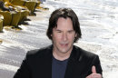 Keanu Reeves seemed to have lost his chiselled looks when he appeared in Cannes