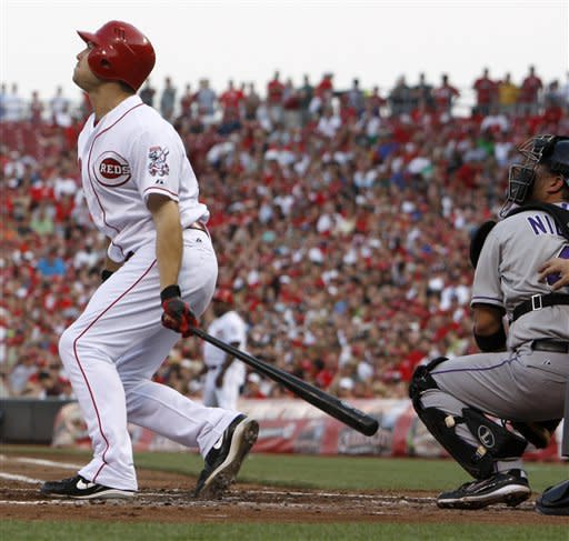 Reds hit 3 homers in 10-3 win over Rockies