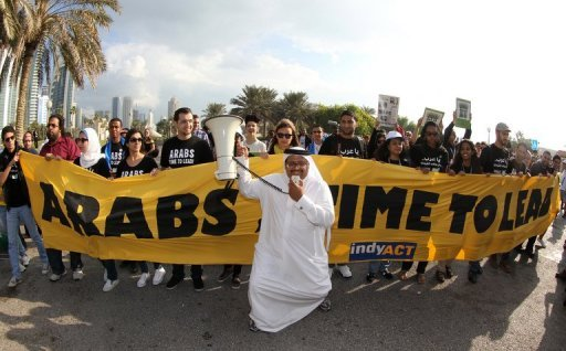 Activists at a rally in Doha on December 1, 2012 to demand urgent action addressing climate change at the United Nations Convention on Climate Change. Iraq's most senior energy official called for coordinated Arab action on climate change while Egypt's environment minister proposed a regional green fund at a conference in Baghdad on Monday
