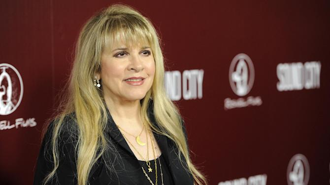 """FILE - This Jan. 31, 2013 file photo shows singer Stevie Nicks at the premiere of the documentary film """"Sound City"""" in Los Angeles. The singer will guest star on an upcoming episode of the FX series. Creator Ryan Murphy revealed the guest spot news Tuesday, Nov. 12, over his official Twitter account. (Photo by Chris Pizzello/Invision/AP, File)"""