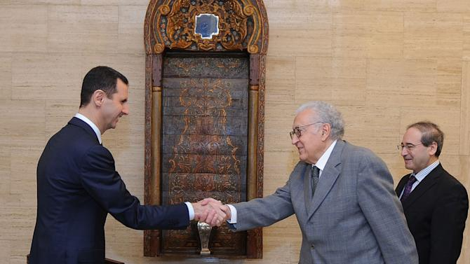 In this photo released by the Syrian official news agency SANA, Syrian President Bashar Assad, left, greets U.N. and Arab League envoy Lakhdar Brahimi prior to their closed-door meeting in Damascus, Syria, Sunday Oct. 21, 2012. Brahimi met with Assad as part of his push for a cease-fire between rebels and government forces for the four-day Muslim holiday of Eid al-Adha, which begins Oct. 26. SANA said Assad assured Brahimi that he supported his effort, but did not say whether he committed to a truce. (AP Photo/SANA)
