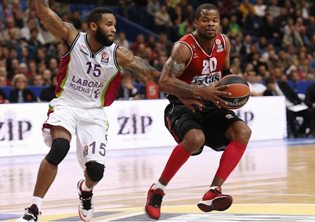 Walter Hodge, left, of  Spain's BC Laboral Kutxa Vitoria  is challenged by Omar Cook  from  Lithuania's BC Lietuvos Rytas during the Euroleague basketball match  in Vilnius, Lithuania, Wednesday, Oct.