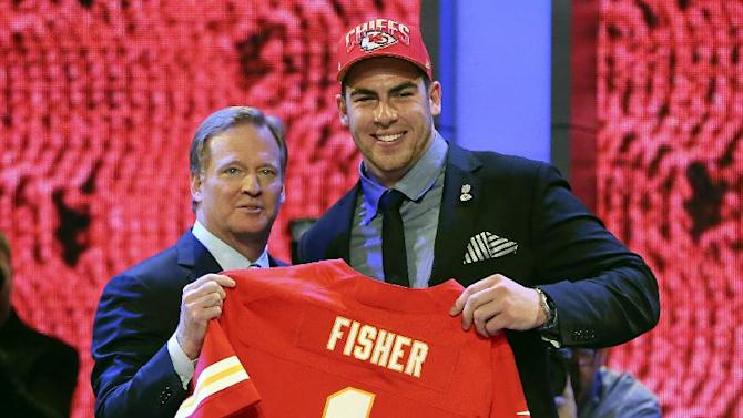 FILE - In this April 25, 2013, file photo, offensive tackle Eric Fisher from Central Michigan stands with NFL commissioner Roger Goodell after being selected No. 1 overall by the Kansas City Chiefs in the first round of the NFL football draft at Radio City Music Hall in New York. a person familiar with the situation tells The Associated Press the Chiefs have agreed to terms on a five-year deal with Eric Fisher. The person spoke on Friday, July 26, 2013, on condition of anonymity because the team has not announced the signing. (AP Photo/Mary Altaffer, File)